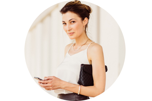 Business woman with mobile phone in hands